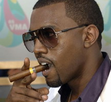 Kanye West smoking a cigarette (or weed)